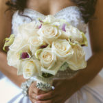 Bride bouquet ivory roses and lavender purple calla lilies